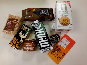 A selection of products from Essential Trading for a food care package